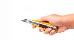 手和切削刀刀子 免版税库存图片