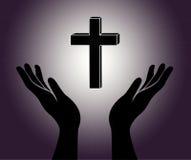 手和十字架 免版税库存照片