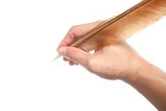 手和羽毛笔 免版税库存图片