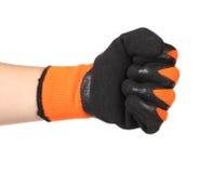 手在一副黑和橙色橡胶手套显示拳头 免版税库存照片