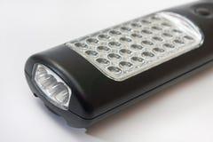手在可再充电电池LED灯 库存图片