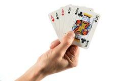 手在四张相同的牌的拿着卡片组合中 图库摄影