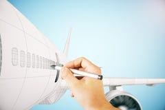 手在蓝色背景的图画飞机 免版税图库摄影