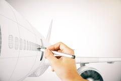 手在轻的背景的图画飞机 免版税库存照片