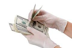 手套的手和美元 免版税库存照片