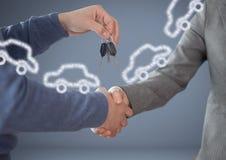 手对负关键与在小插图前面的汽车与握手 库存图片