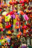 手工制造五颜六色的织品动物形状钥匙链 免版税库存图片