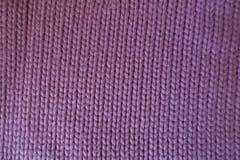 手工制造桃红色简单的下针织品 免版税库存照片