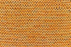 手工制造橙色编织的纹理背景 库存图片