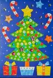 手工制造由圣诞节装饰、圣诞树和礼物的小孩马赛克 库存图片
