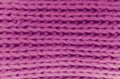 手工制造红色羊毛被编织的织品 免版税库存照片