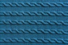 手工制造蓝色编织的羊毛织品纹理 免版税库存照片