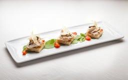 Crostini di focaccia,意大利美好的用餐的开胃菜 库存图片