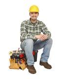 手工工具箱工作者年轻人 免版税库存照片