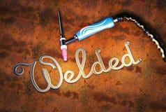 手工氩弧焊把柄,题字在金属片焊接了 图库摄影