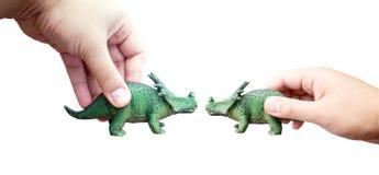 手抓住恐龙玩具 免版税库存图片