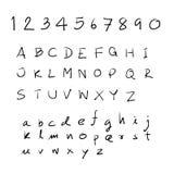 手拉剪影的字母表 库存照片