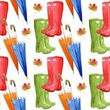 手拉的与秋天元素的水彩无缝的样式 伞,叶子,胶靴 免版税图库摄影