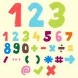 手拉的五颜六色的数字和标志 免版税库存照片
