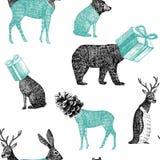手拉的冬天动物无缝的背景 库存图片