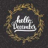 手拉的印刷术字法词组你好, 12月在与金黄花圈的黑板背景隔绝了 免版税图库摄影