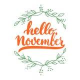 手拉的印刷术字法词组你好, 11月在白色背景隔绝了 乐趣刷子墨水书法 免版税库存照片