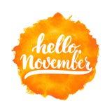 手拉的印刷术字法词组你好, 11月在白色背景隔绝了 乐趣刷子墨水书法 图库摄影