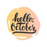 手拉的印刷术字法词组你好, 10月在白色背景隔绝了 免版税库存照片