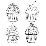 手拉的套鲜美杯形蛋糕 免版税库存图片
