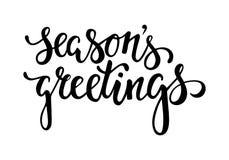 手拉的字法季节` s问候 假日贺卡和邀请的设计 库存照片