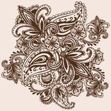手拉的无刺指甲花Mehndi摘要坛场花和佩兹利乱画 库存照片