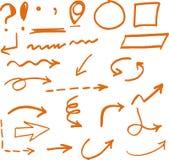 手拉的橙色箭头圈子和抽象乱画 图库摄影