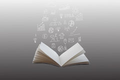 手拉的财政从一本开放书出来的计划和图 免版税库存图片