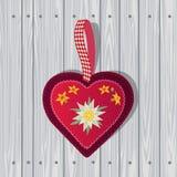 手拉的edelweiss在木背景的红心 向量例证