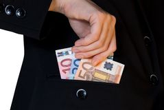 在口袋的金钱 免版税库存照片