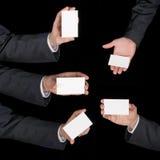 手举行在黑色的名片拼贴画 免版税库存照片