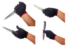 手拿着有黑手套的套刀子 免版税图库摄影