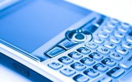 手持式蓝色数字式的电子邮件 免版税库存照片
