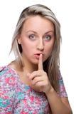 手指她的嘴唇妇女 库存照片