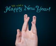 手指愉快的新的符号面带笑容年 免版税库存图片