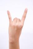 手指手标志在白色背景的概念恶魔垫铁摇滚乐姿态形状 库存图片