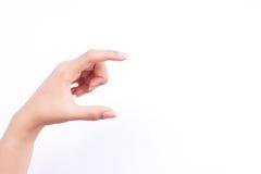 手指手标志概念妇女手拿着一台未来派名片或照相机的或者在白色背景的手机 免版税库存图片