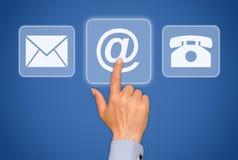 手指按与我们联系按钮 免版税库存图片