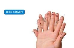 手指组愉快的面带笑容 代表社会网的手指 库存图片