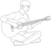 手指重点演奏锐利的吉他人 免版税库存图片