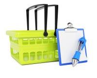 手提篮和清单 免版税库存照片