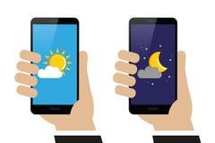 手日夜拿着有天气预报的智能手机 库存例证
