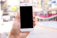 手智能手机的藏品嘲笑有城市街道背景 图库摄影