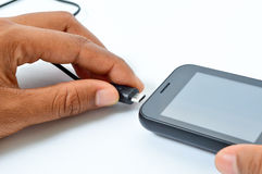 手机充电 免版税图库摄影