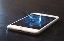 手机和水飞溅 免版税库存图片